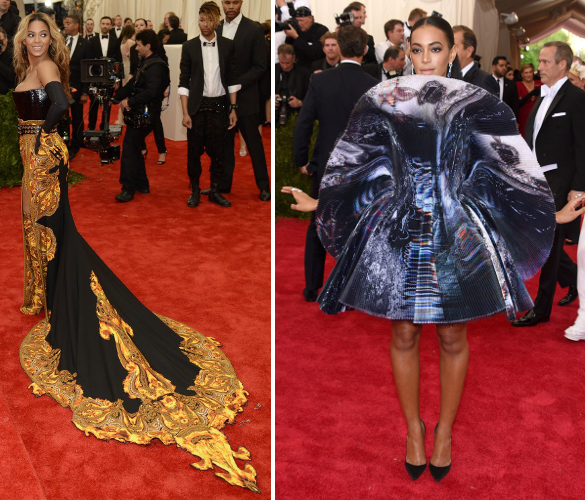 Singer Beyonce is inspired by the symbol of the Coin Lords while her sister Solange dresses as a tower shield